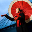 Beautiful young woman with red umbrella on rainy day — Stock Photo #4804188