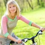 Beautiful young woman relaxing after riding a bike — Stock Photo #4804192