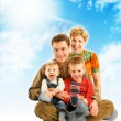 Happy family over blue sky — Stock Photo