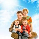Happy family over blue sky — Stock Photo