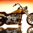 Motorcycle on abstract background - Stock Photo