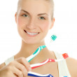 Beautiful young woman with three different types of toothbrushes — Stock Photo #4804330