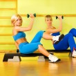 Beautiful women exercising in fitness club — Foto Stock