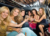Group of beautiful women clinking glasses with champgagne inside — Foto de Stock