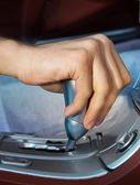 Driver's hand changing speed — Stock Photo