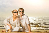 Young beautiful couple relaxing on the beach — Stock Photo