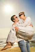 Young happy couple having fun on the beach — Stock Photo