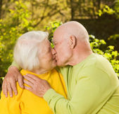 Kissing senior couple — Stock Photo