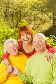 Senior couple with their daugther outdoors — Stock Photo