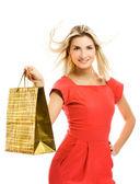 Mooie jonge vrouw met een zak. geïsoleerd op witte achtergrond — Stockfoto
