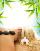 Massage with hot volcanic stones — Stock Photo