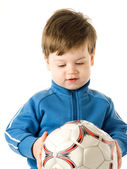 Handsome little boy holding soccer ball isolated on white backgr — Stock Photo