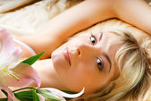Beautiful girl with pink lily — Stock Photo