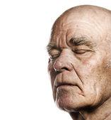 Elderly man's face over white background — Stock Photo