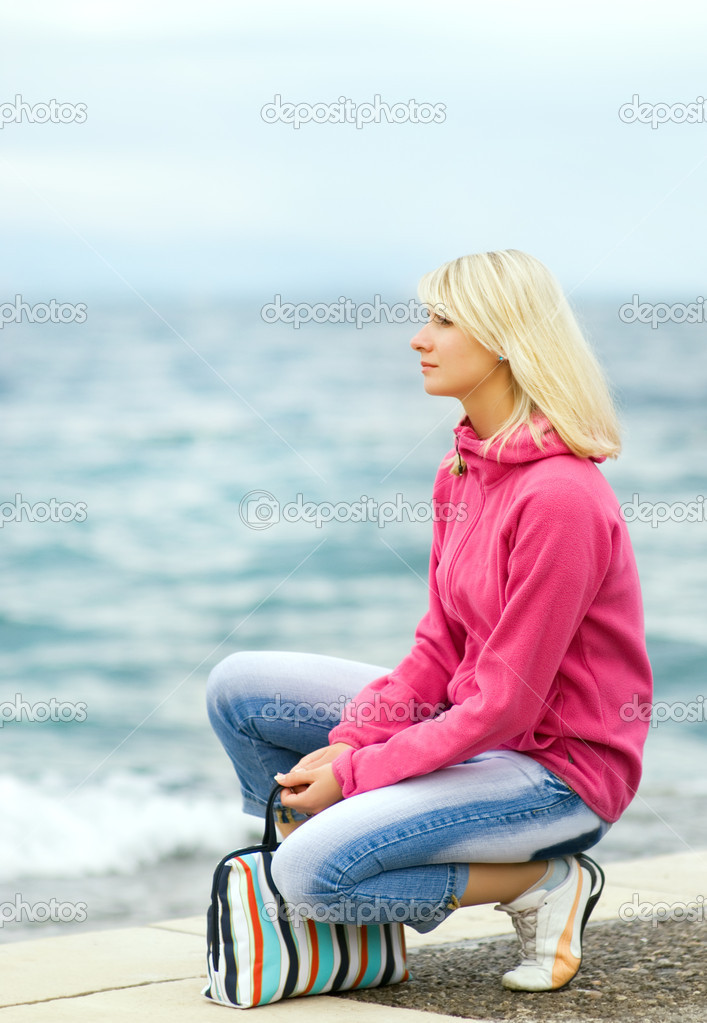 Sad woman sitting near the ocean — Stock Photo #4800707