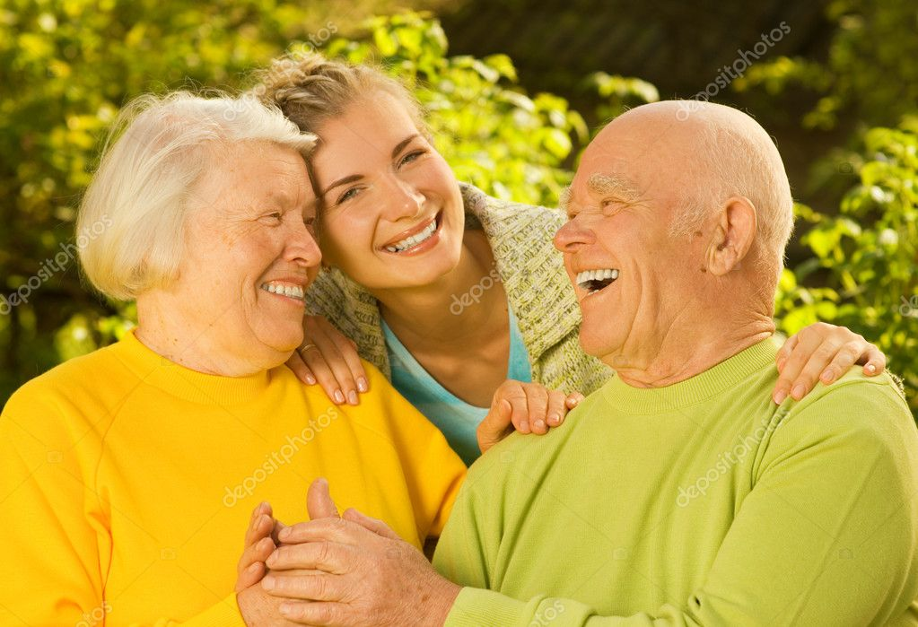 Grandparents with granddaughter outdoors — Stock Photo #4803845