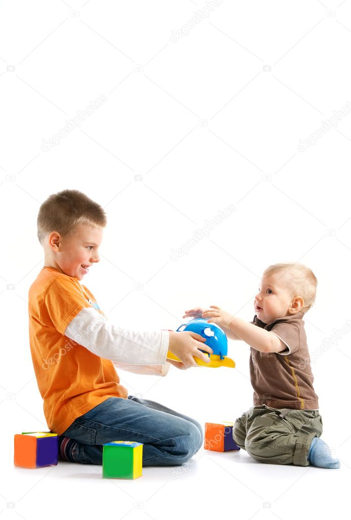 Two kids playing together over white background — Stock Photo #4804374