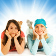 Two pretty teenage girls isolated on abstract background — Stock Photo
