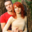 Stock Photo: Young attractive couple in a forest