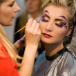 Make-up artist at work - Stock Photo