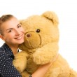 Beutiful young happy woman with big teddy bear toy — Stock Photo #4839959