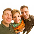 Funny close-up portrait of three friends isolated on white backg — Stock Photo