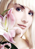 Beautuful woman with pink lily high-key portrait — Stock Photo