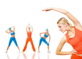 Group of women doing fitness exercise isolated on white. Lots of — Stock Photo