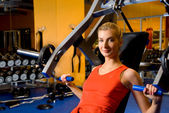 Beautiful woman works out in a gym — Foto Stock