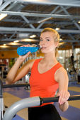 Beautiful woman relaxing after fitness exercise — Stock Photo