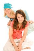 Two teenage girls isolated on white background — Stock Photo
