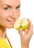 Young beautiful woman with apple slice isolated on white backgro — Stock Photo