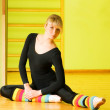 Ballet dancer doing stretching exercise on a floor — Stock Photo #4840005