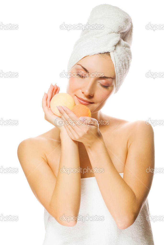 Beautiful young woman with aroma bath ball isolated on white background — Stock Photo #4840008