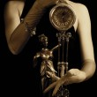 Sepia picture of a clock and beautiful young girl (focus on cloc — Stock Photo