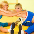 Beautiful women exercising in fitness club — Stock Photo
