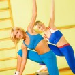 Beautiful women exercising in fitness club - Foto Stock