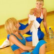 Stock Photo: Beautiful women relaxing after fitness exercise