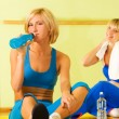 Beautiful women relaxing after fitness exercise — Stock Photo
