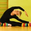 Ballet dancer doing stretching exercise on a floor — Stock Photo #4903114