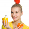 Funny girl with sweet peppers — Stock Photo