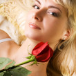 Young beautiful woman with red rose — Stock Photo #4903156