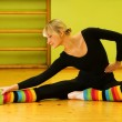 Ballet dancer doing stretching exercise on a floor — Stock Photo #4903204