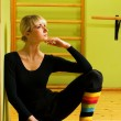 Beautiful ballet dancer sitting on a floor and relaxing after ex — Stock Photo #4903205