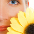 Beautiful woman with a sunflower - Stockfoto