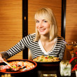 Girl in a restaurant — Stock Photo #4903278