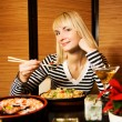 Girl in a restaurant - Stock Photo