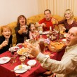 Happy family celebrating - Stock Photo