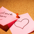 Love message on a corkboard - Stock Photo