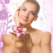 Beautiful girl with orhid flowers in rendered water — Stock Photo #4903435